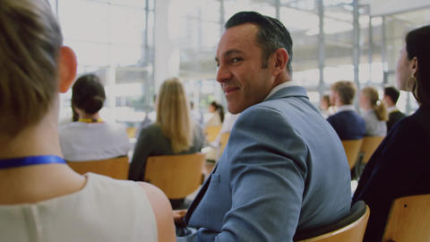 Businessman looking at camera during seminar 4k Live Action
