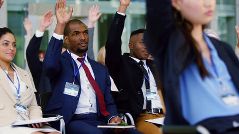 Business people raising their hands in a business seminar 4k Live Action