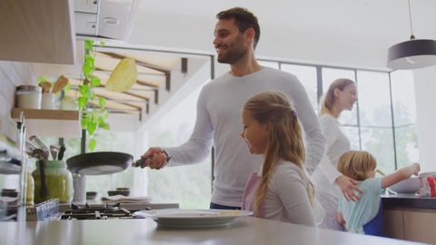 Family preparing food in kitchen at home 4k Live Action