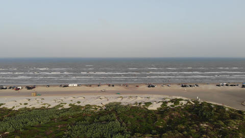 Lateral movement showing coastline, beach, grassland Live Action