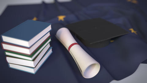 Graduation cap, books and diploma on the flag of Alaska. Higher education in the Live Action