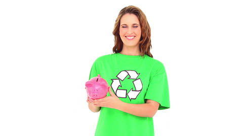 Smiling environmental activist showing piggy bank Live Action