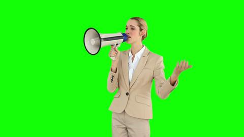 Positive businesswoman shouting through megaphone Live Action