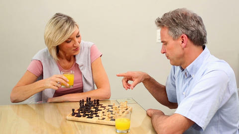 Mature couple playing chess at the table Live Action