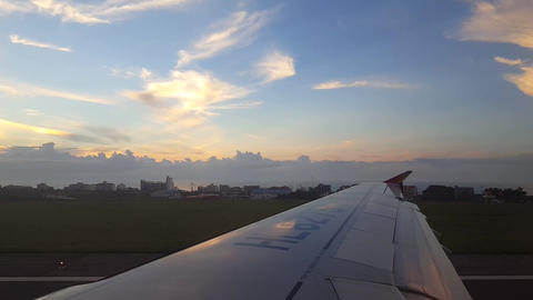 the scene outside the window of an airplane taking off Live Action