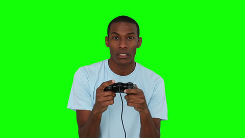 Casual young man playing video games Live Action