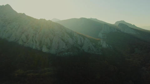 Fly Over Majestic Mountain Peaks At the Sunset Golden Hour Live Action