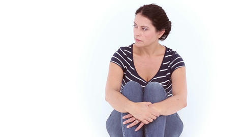Unhappy woman sitting on the floor Live Action
