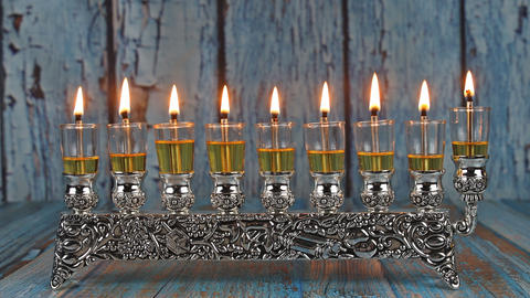 Orthodox jewish light a hanukkah menorah with olive oil candles Live Action