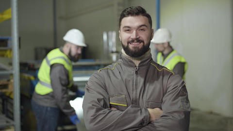 Portrait of confident Caucasian man looking at camera and smiling. Foreman with Live Action