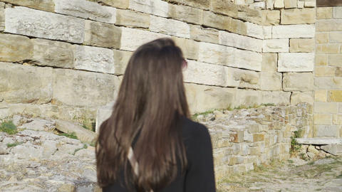 Woman walking trough medieval stronghold Tsarevets impressed by the look of the Live Action