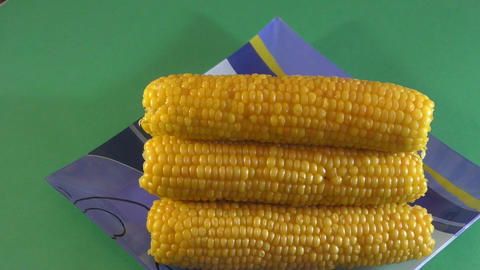 Boiled corn on the dinner table Footage
