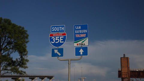 Hghway 35E south and Sam Rayburn Tollway signs Stock Video Footage