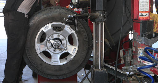 Mechanic spin balance wheel tire machine shop DCI 4K 296 Footage
