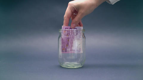Woman Puts Euro 500 into a Glass Jar Footage
