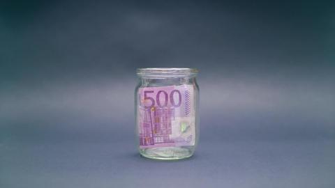 Woman Puts Euro 500 into a Glass Jar Footage
