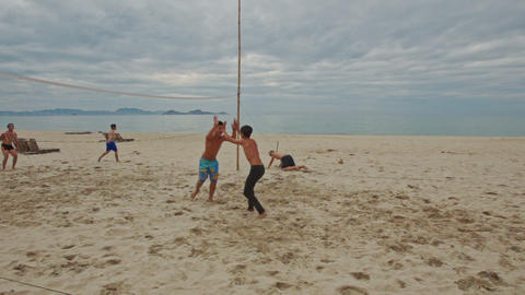 Guys Play Beach Volleyball on Large Sand Beach Footage