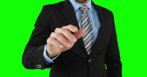 Businessman using an invisible touchscreen Live Action