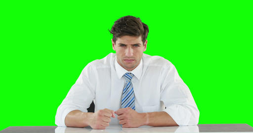 Worried businessman banging his fists Live Action