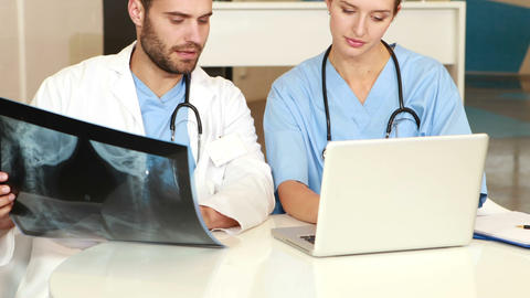 Doctors examining Xray scan Live Action