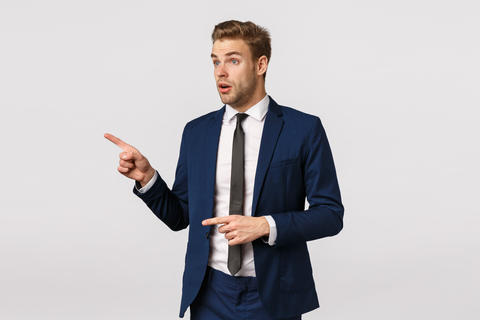 Surprised and speechless amazed businessman in classic suit, pointing staring Photo
