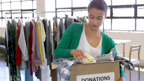 Casual woman looking at donations Live Action