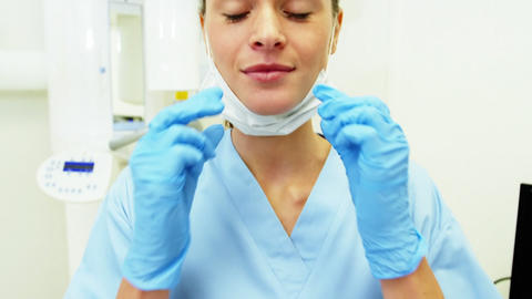 Dental assistant wearing surgical mask Live Action