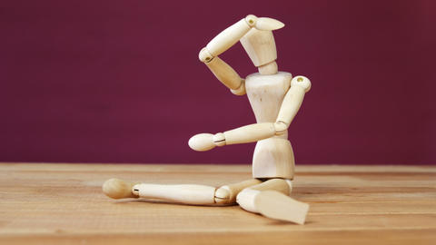 Figurine performing stretching exercise Live Action