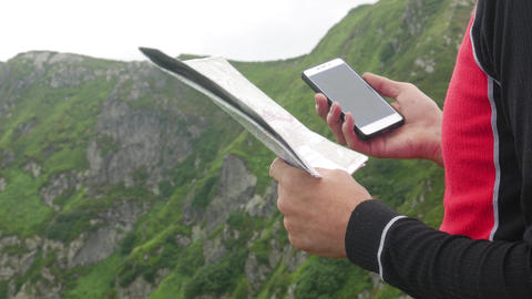 Man Searching Direction with Map and Electronic Compass on Smartphone Live Action