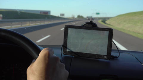 Driving with GPS Device on Dashboard Footage