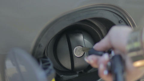 Female hand opening fuel filter cap with car key Footage
