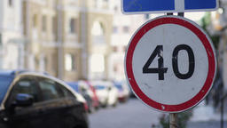 Speed limit sign in the city street on summer day Live Action