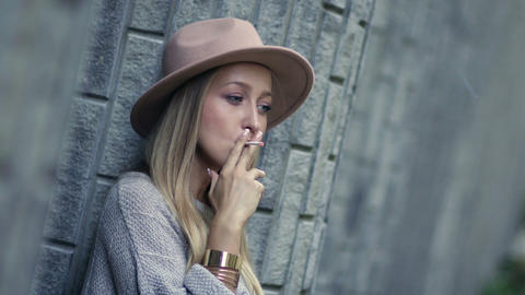 Sad lonely woman smoking cigarette and thinking Footage