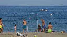People playing beach volleyball on the beach one summer afternoon Footage
