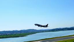 Corfu Kerkira Airport travel 4k video. Aircraft plane takeoff from runway, water Footage