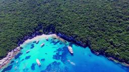 Tropical Ionian Greece Blue Lagoon island 4k video. Ocean sea coast yacht boat Footage