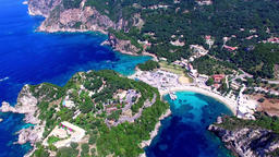 Flight aerial Paleokastritsa bay Greece Corfu 4k video. Village sea rocky coast  Footage