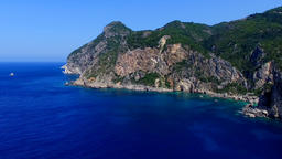 Flight over ocean sea Greece Corfu cliff rocky coast aerial HD video. Rugged Footage