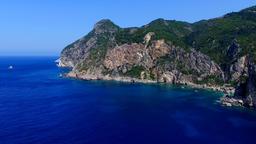 Flight over ocean sea Greece Corfu cliff rocky coast aerial HD video. Rugged Footage