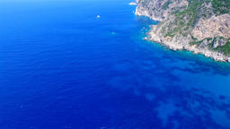 Flight over ocean sea water surface Greece Corfu cliff rocky coast HD video Footage