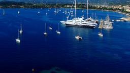 Corfu Marina harbor yachts boat ship Greece aerial HD video. Garitsa Bay sea Footage