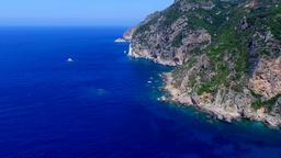 Flight over ocean sea water surface Greece Corfu cliff rocky coast HD video Footage
