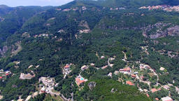 Corfu Paleokastritsa Greece village aerial HD video. Mountain hills, villas reso Footage