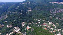 Corfu Paleokastritsa Greece village aerial HD video. Mountain hills, villas reso Footage