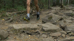 legs of male athlete running from mountain Footage