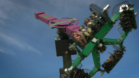 People Riding Carnival Ride, Close, 4K Footage