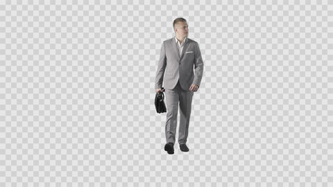Young Male in gray suit is walking at the camera. Green screen video Footage