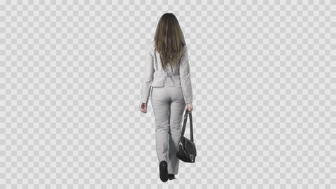 Beautiful brunette woman in gray attire is slowly walking from the camera Footage