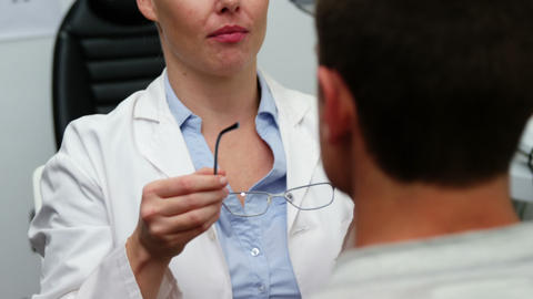 Female optometrist prescribing spectacles to patient Live Action