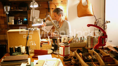 Attentive craftswoman working Live Action